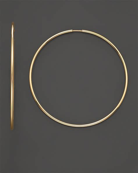 14 kt yellow gold large endless hoop earrings