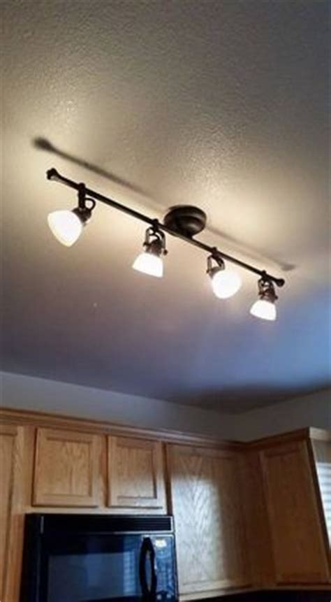 replace fluorescent light in kitchen with track lighting how to replace fluorescent lighting with a pendant fixture