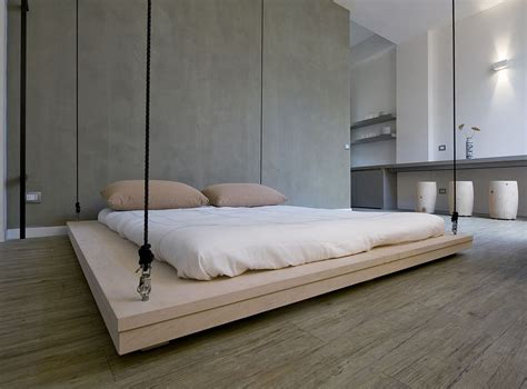 suspended bed space saving bed raises to become ceiling art by renato arrigo