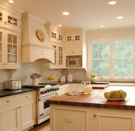 white kitchens with butcher block light cabinets dark countertops subway tile backsplash