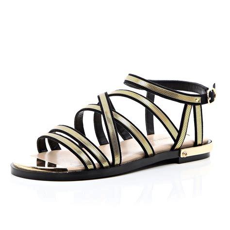 black and gold gladiator sandals river island black and gold strappy gladiator sandals in