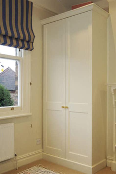 built in wardrobe in sloped alcove in loft room