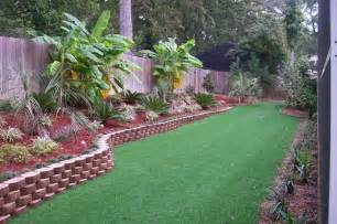Tropical Backyard Landscaping Ideas Lake Olmstead Backyard Tropical Landscape Other Metro By Pines Landscaping Llc