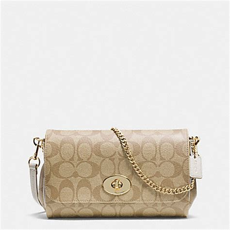 Coach Mini Signature Chalk 1 mini ruby crossbody in signature canvas f34615 light gold light khaki chalk coach