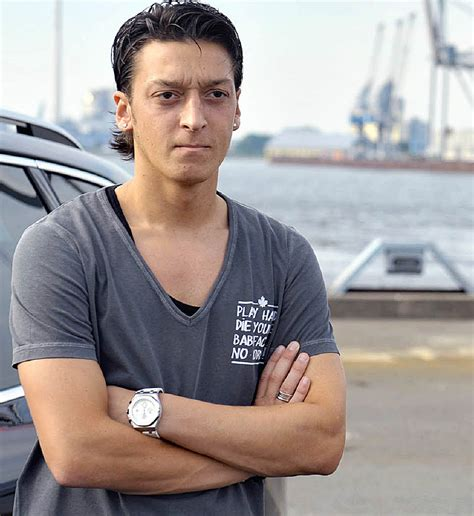 mesut ozil new haircut sports accessin mesut ozil photo 2012