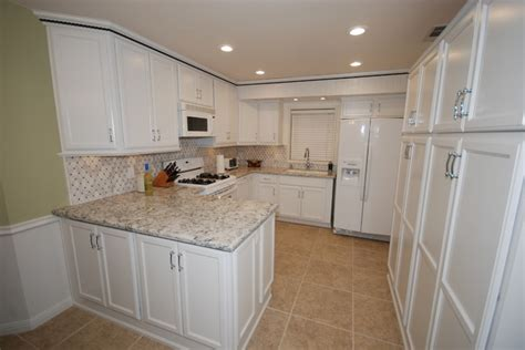 cambria praa sands white cabinets backsplash ideas dovewhite praa sands traditional kitchen other