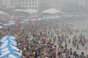 Housedesigners summer in shandong thousands pack onto qingdao beach in