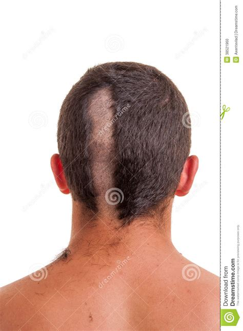 photo of the back of hair with a short bob back of man head while his hair is cut stock photo image