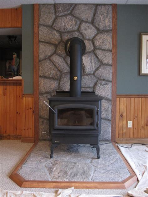 regency wood burning stove with 5 point granite hearth and