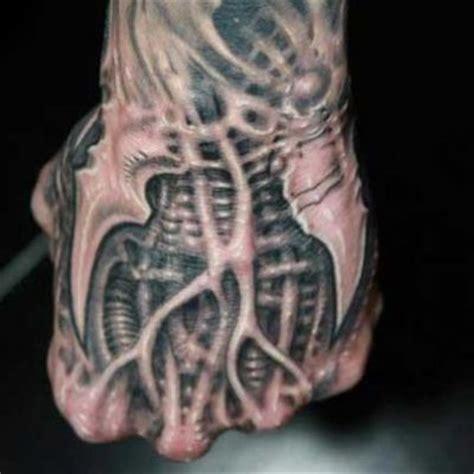 tattoo biomechanical hand biomechanical hand tattoo tattoos and piercings pinterest