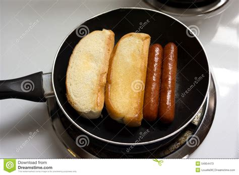 how to cook dogs in a pan dogs cooking in pan stock photo image 54954473