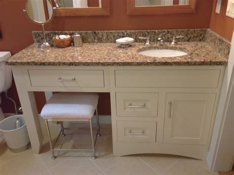bathroom vanity with sink and makeup area