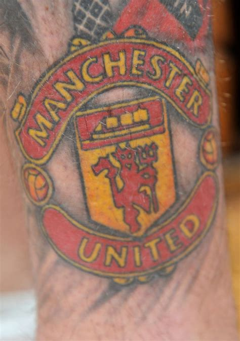 manchester united tattoo fan honors manchester united with tattoos tattoodo