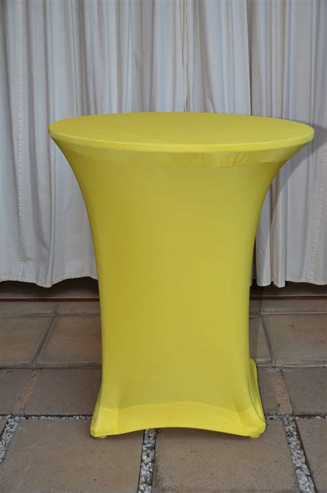 yellow ottoman coffee table yellow stretch tablecloth the tablecloth hiring company