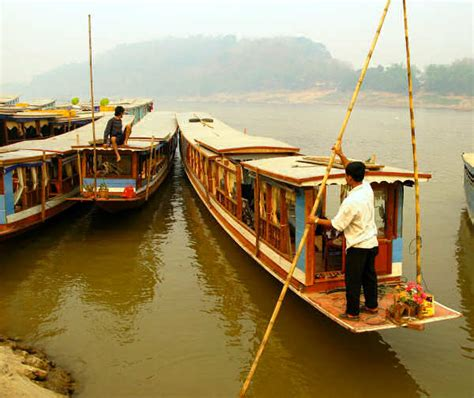 boat engine turns over slow laotian mekong wooden boats slow boats and plank canoes