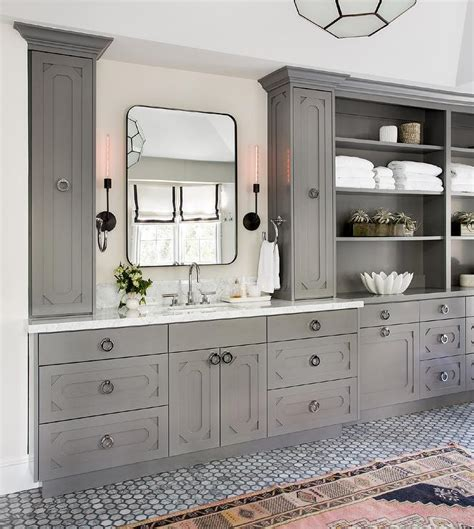 light grey bathroom cabinets  glass knobs