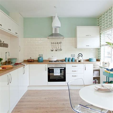 pastel kitchen ideas traditional kitchen with pastel green walls green walls