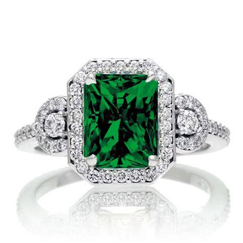1 5 carat emerald cut three emerald halo
