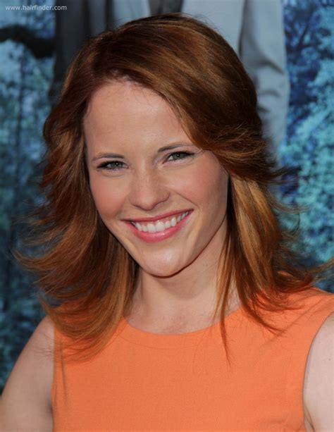 katie leclerc flippy hairstyle  warm red hair