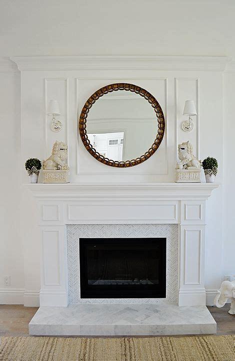 white wood fireplace paneling carrara marble