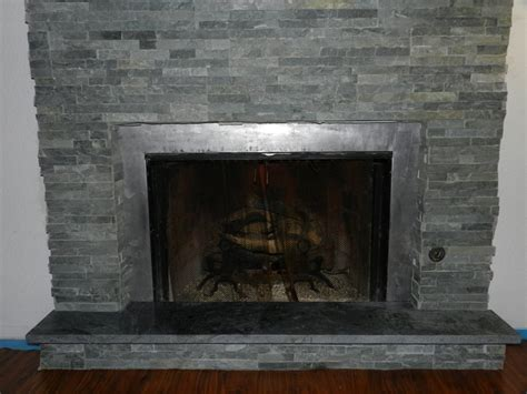 Soapstone Hearth ledge tile installation around fireplace with soapstone hearth already in place by