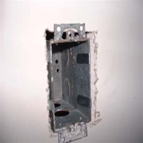 guide to cutting outlet holes in drywall to install an