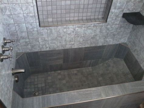 roman style bathtub tile tub check this out this is a roman style tub in a