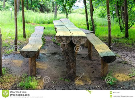 tables made from logs table and benches made of logs in the park stock image
