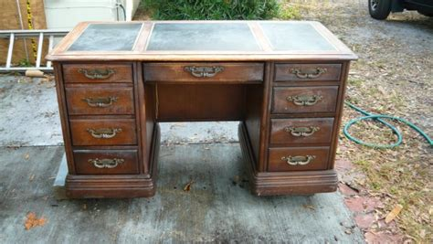 how much is my couch worth how much is this antique desk worth how old is it
