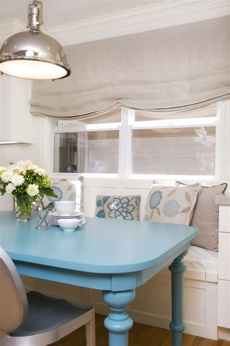 lovely built in breakfast nook with blue table d i n i