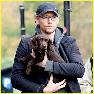 tom hiddleston puppy tom hiddleston carries adorable puppy in his arms in 15 mi