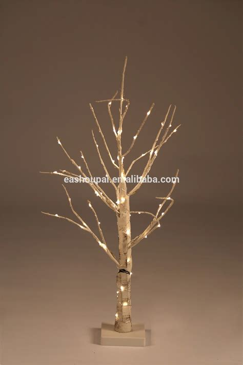 tree lights white wire copper wire wrapped big white artificial tree