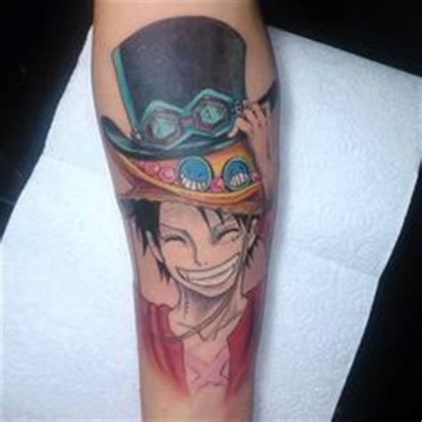 one piece character tattoo anime one piece character portgas d ace tattoos geeks