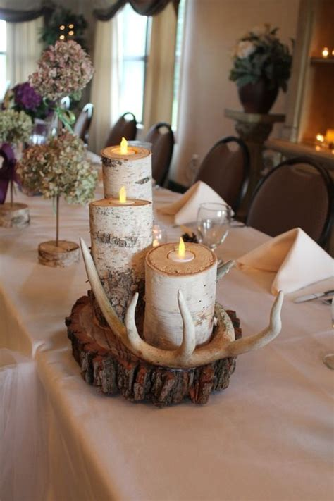 rustic wedding table decorations birch tree candles and antlers with floral centerpieces