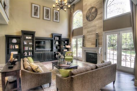 great room layout ideas two story great room with windows doors beside fireplace