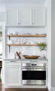 stacked wood kitchen shelves with iron brackets