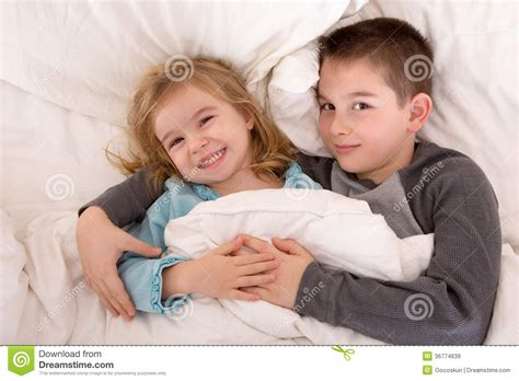 brother and sister in bed mischievous young brother and sister in bed royalty free