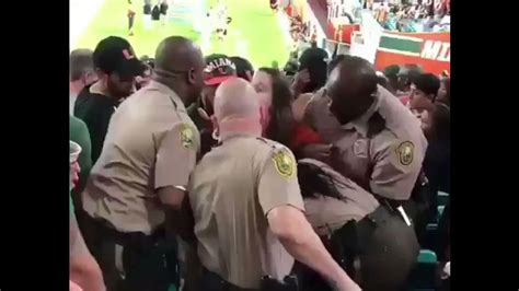 officer punches miami fan investigating altercation between miami fan