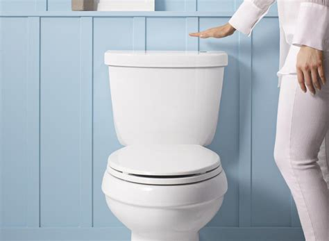 bathroom flush make your toilet touchless with kohler s new wave to