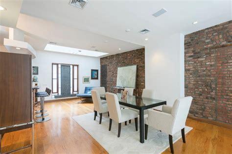 the living room has 10 foot ceilings oak hardwood floors five story chelsea townhouse with 22 foot ceilings renting