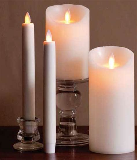 Battery Candles by 8 Inch Ivory Moving Battery Operated Taper Candle