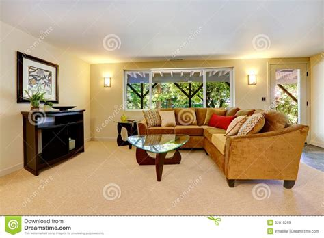 beige carpet living room living room with large sofa window and carpet royalty free stock images image 32018269