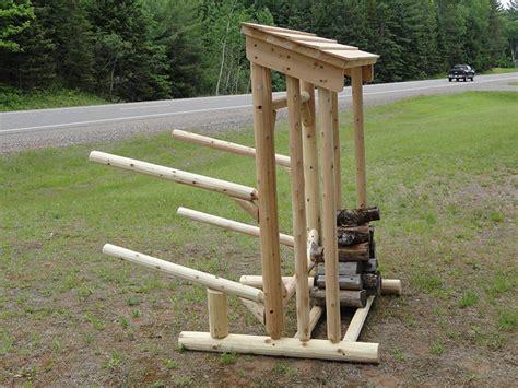 place log kayak rack wood storage wood shelter kayak rack