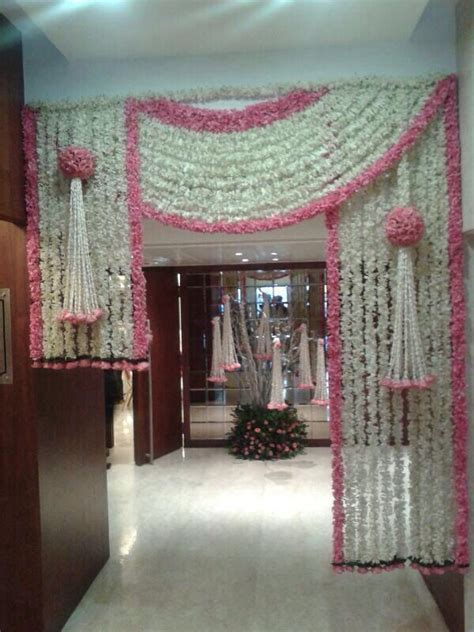 entrance decor with florals for a pink and white theme
