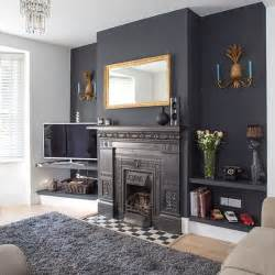 traditional living room with grey painted feature wall