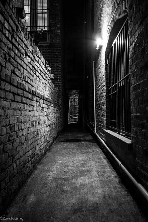 door at end of dark alleyway | An alley or alleyway is a