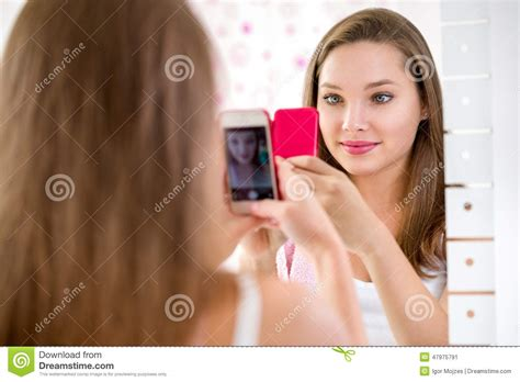 girl selfie in bathroom beautiful teenager girl taking selfie in bathroom stock