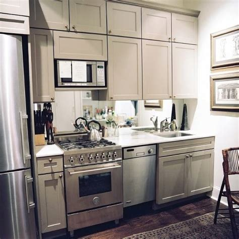 Antique Grey Kitchen Cabinets by Gray Cabinets With Antique Brass Handles
