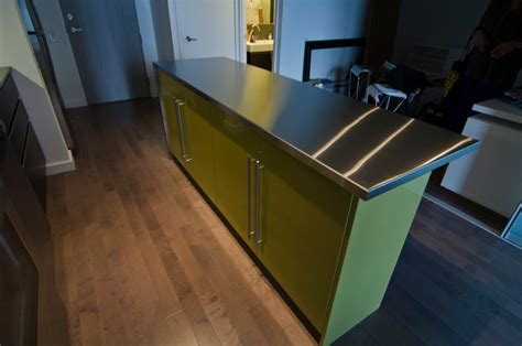 stainless steel kitchen island ikea ikea island with custom thermofoil doors and stainless steel countertop modern kitchen