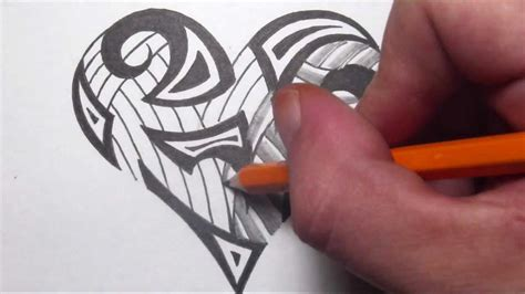 drawing tribal maori shapes inside a heart tattoo design